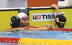 JAKARTA, Aug. 24, 2018  Liu Xiang (C) of China congrats Ikee Rikako (L) of Japan after women's 50m freestyle final of swimming at the 18th Asian Games in Jakarta, Indonesia, Aug. 24, 2018. Ikee won the gold medal. (Credit Image: © Pan Yulong/Xinhua via ZUMA Wire)