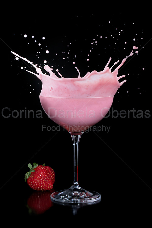 Splash in a glass with strawberry smoothie.<br /> For sale as NFT on OpenSea limited edition of 8 https://bit.ly/strawberrycocktailnft