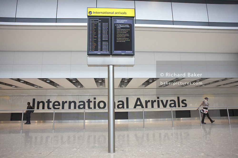 Looking at International Arrivals of Heathrow airport's Terminal 5. Designed by architects Richard Rogers Partnership the controversial building opened with chaotic scenes on 27/3/08. British Airways passengers faced baggage disruption after a 6 year construction project that has seen the British public divided over the role of commercial aviation. At a cost of £4.3bn, the project was Britain's longest planning inquiry which lasted four years but finally employing a total of 60,000 workers. 30,000 square metres of glass in walls; 80,000 tonnes of steel were used - 17,000 in the roof alone; 5,000 doors, 800 toilets, 20,000 power sockets and 1,700 miles of cable; 60 new aircraft stands, including 14 for the Airbus A380; 13km of tunnels were bored for the state-of-the-art baggage handling to handle 12,000 bags per hour.