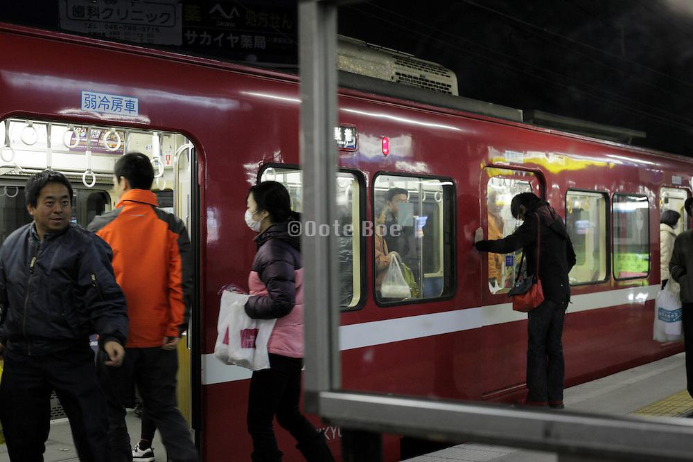 railway commuters after dark Japan