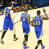 10 June 2016: Golden State Warriors guard Klay Thompson (11) is seen next to Golden State Warriors forward Andre Iguodala (9) and Golden State Warriors forward Draymond Green (23) during the Golden State Warriors 108-97 victory over the Cleveland Cavaliers, during Game Four of the 2016 NBA Finals at the Quicken Loans Arena, Cleveland, Ohio, USA.