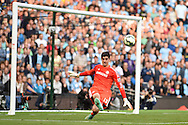 Chelsea goalkeeper Thibaut Courtois in action. Barclays premier league match, Manchester city v Chelsea at the Etihad stadium in Manchester,Lancs on Sunday 21st Sept 2014<br /> pic by Andrew Orchard, Andrew Orchard sports photography.