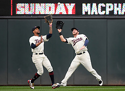 August 17, 2017 - Minneapolis, MN, USA - Minnesota Twins center fielder Byron Buxton, left, and right fielder Robbie Grossman collide as they chased down a fly ball, caught by Buxton, hit by the Cleveland Indians' Carlos Santana in the second inning during the second game of a doubleheader on Thursday, Aug. 17, 2017, at Target Field in Minneapolis. (Credit Image: © Aaron Lavinsky/TNS via ZUMA Wire)