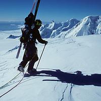 ANTARCTICA, Ski mountaineers (MR) atop Mt.Berry, Danco Coast, Antarctic Peninsula Detroit Plateau, bkg.