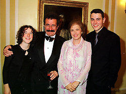 Centre, LORD & LADY WINSTON and their children, left the HON.TANYA WINSTON and right, the HON.BEN WINSTON, at a ball in London on 13th October 1999.MXP 6