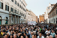 ROME, ITALY - 21 APRIL 2013: Supporters of the Five-Star Movement who gathered in Piazza Santi Apostoli for are ready to march towards the Colosseum the day after the re-election of President Giorgio Napolitano,  in Rome, Italy, on April 21, 2013.<br /> <br /> Italy's lawmakers re-elected 87-year-old President Giorgio Napolitano on Saturday in a bid to break the country's political gridlock, as protestors outside parliament protested agains the result. Giorgio Napolitano won with a  majority of 738 ballots out of 1,007 possible votes, ahead of leftist academic Stefano Rodota, backed by the the anti-establishment Five Star Movement, who scored 217.