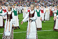 Lithuanian Song Celebration (Song and Dance Festival) 90th anniversary, Vilnius, Lithuania (5 July 2014). Pictured here, Dance Day - a huge, elaborately choreographed traditional dance performance, held in the Zalgiris Stadium in Vilnius. The Song Celebration in Vilnius is Lithuania's greatest cultural event, occurring only once every four years, and along with similar festivals in Latvia and Estonia, is inscribed on the UNESCO list of Intangible Cultural Heritage. © Rudolf Abraham.