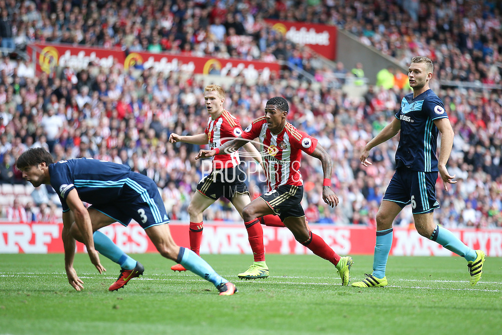 Sunderland defender Patrick van Aanholt (3) follows up Sunderland forward Duncan Watmore (14)  shot that is saved by Middlesbrough goalkeeper Brad Guzan (12)  to score a goal to make the score 1-2 during the Premier League match between Sunderland and Middlesbrough at the Stadium Of Light, Sunderland, England on 21 August 2016. Photo by Simon Davies.