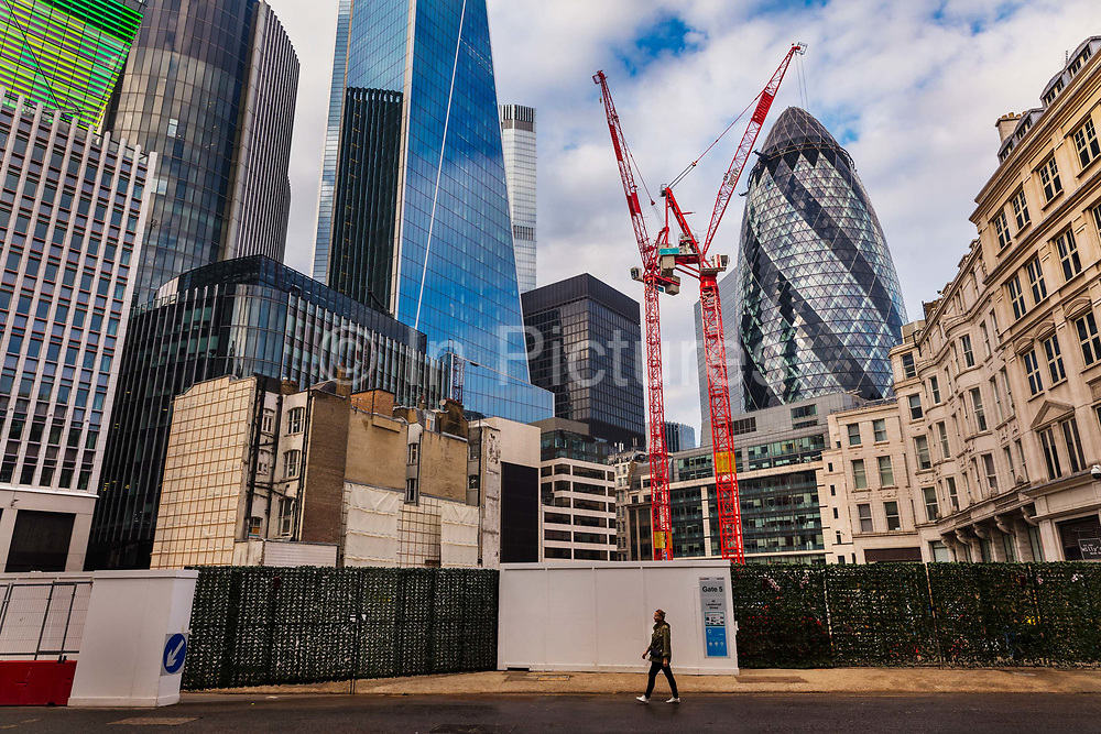 View of the Leadenhall Building and the Gherkin soaring over a new developments on Fenchurch Street during the second national coronavirus lockdown on 8th November 2020 in London, United Kingdom. The new national lockdown is a huge blow to the economy and for individuals who were already struggling, as Covid-19 restrictions are put in place until 2nd December across England, with all non-essential businesses closed.