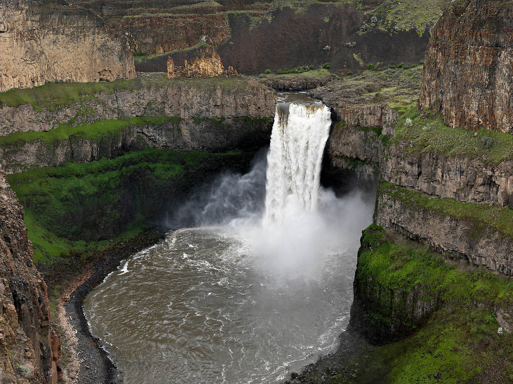 Palouse Falls drop spring runoff. The Palouse Falls lie on the Palouse River, about 4 mi (6 km) upstream of the confluence with the Snake River in southeast Washington, United States. The falls are 198 ft (60 m) in height. The falls consist of an upper fall with a drop around 20 ft (6.1 m), which lies 1,000 ft (305 m) north-northwest of the main drop, and a lower fall, with a drop of 198 ft (60 m).  Licensing and Open Edition Prints