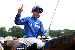 Jim Crowley celebrates on Battaash after winning the King's Stand Stakes during day one of Royal Ascot at Ascot Racecourse.