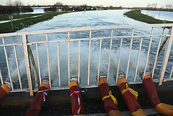 © London News Pictures. 01/02/2014. Long Load, UK. Water being pumped from the histories Long Load bridge in Long Load near Muchelney, Somerset, an area hit by severe flooding. The bridge is closed while pumping is ongoing 24 hours a day.Photo credit: Jason Bryant/LNP