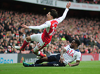 Football - 2016 / 2017 Premier League - Arsenal vs. Tottenham Hotspur<br /> <br /> Danny Rose of Tottenham fouls Hector Bellerin of Arsenal at The Emirates.<br /> <br /> COLORSPORT/ANDREW COWIE