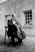 The cellist of the Dehler Quartet before a performance at chateau Talcy, a historic site in France's Loire Valley.