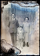 eroding glass plate photo of parents with child