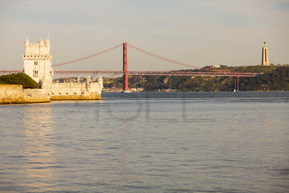 Tagus river view from Champalimaud Center for the Unknown, with Belém tower on the left, 25th of April bridge in the center and Cristo-Rei (King Christ) on the right side.