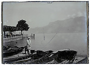 glass plate of woman standing by rowing boats 1900s