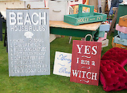 Funny signs on display at a car boot sale, UK