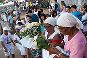 Women from Bahia prepare flowers to make as offerings to Yemanja. February 2nd is the feast of Yemnaja, a Candomble Umbanda religious celebration where thousands of adherants to these faith religions go to Rio Vermehlo Red River to make offerings of flowers and prayers, paying their respects to Yemanja, the Orixa goddess of the Sea and water