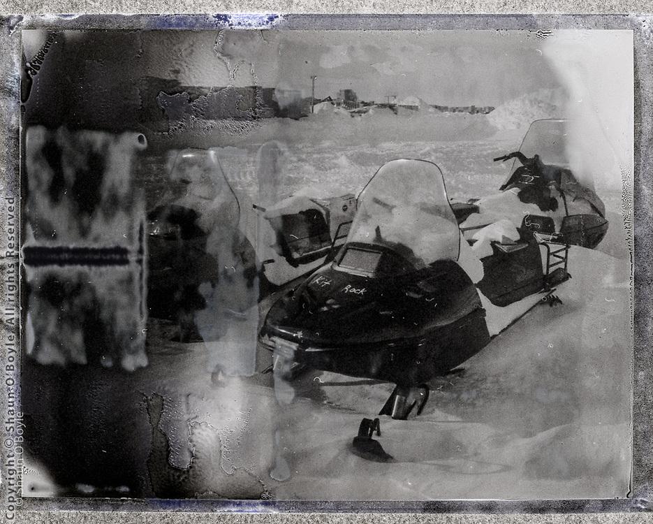 Kit Rock snowmobile in South Pole backyard. Polaroid camera with Fuji instant film.