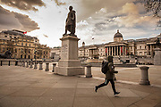A normally crowded Trafalgar Square was deserted as Coronovirus clampdown began on Friday evening rush hour on 20th March 2020 in London, United Kingdom. All bars and resturants were being closed at this time throughout the UK.
