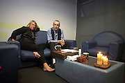 Barefoot Rick Parfitt and Francis Rossi of Status Quo relax in a dressing room on European tour Lille, France.