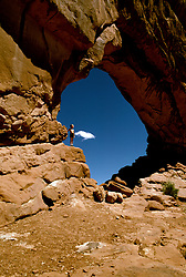 UT: Utah; Arches National Park, South Window Arch, model released.           .Photo Copyright: Lee Foster, lee@fostertravel.com, www.fostertravel.com, (510) 549-2202.Image: utarch220.
