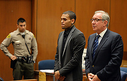 July 15, 2013 - Los Angeles, California, U.S - R&B singer Chris Brown, left, and his Attorney Mark Geragos appear during a court hearing at Los Angeles Superior court in Los Angeles Monday, July 15, 2013. A Los Angeles judge has revoked Chris Brown's probation after reading details of an alleged hit-and-run accident and his behavior afterward, but the singer was not ordered to jail. The prosecutor did not ask for Brown to be jailed. Another hearing is set for Aug. 16.  The singer has been on felony probation in the 2009 beating of former girlfriend Rihanna. (Credit Image: © Prensa Internacional/ZUMAPRESS.com)