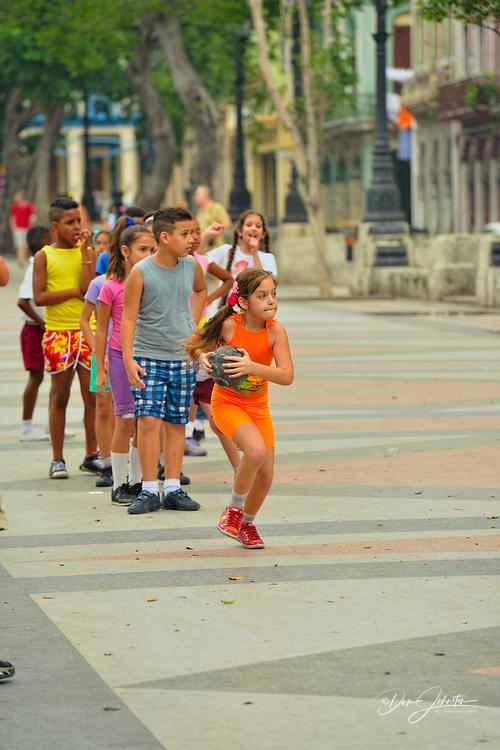 Organized play on the Prado with a group of schoolchildren, La Habana (Havana), Habana, Cuba