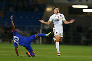 Kalvin Phillips of Leeds Utd ® controls the ball and goes past Loic Damour of Cardiff city. EFL Skybet championship match, Cardiff city v Leeds Utd at the Cardiff city stadium in Cardiff, South Wales on Tuesday 26th September 2017.<br /> pic by Andrew Orchard, Andrew Orchard sports photography.