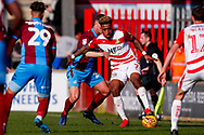 Doncaster Rovers forward Mallik Wilks (7), on loan from Leeds United shields the ball during the EFL Sky Bet League 1 match between Scunthorpe United and Doncaster Rovers at Glanford Park, Scunthorpe, England on 23 February 2019.
