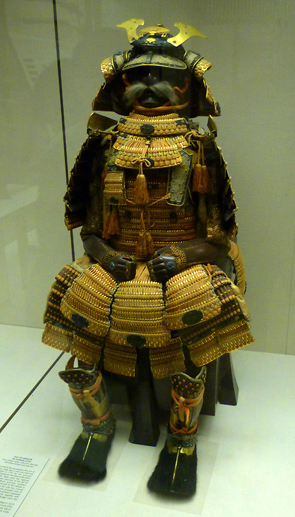 Suit of armour belonging to a Japanese Samurai warrior, circa 1560. This suit of armour was made during the  Edo period, during which, samurai wore armour only on ceremonial occasions. lacquered metal joined by silk cords.