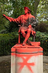 © Licensed to London News Pictures. 12/10/2021. London, UK. Extinction Rebellion Youth Solidarity protesters defaced the Christopher Columbus statue in Belgravia Square. The action was calling for thew statue to be removed on Indigenous People Day. Photo credit: Ray Tang/LNP