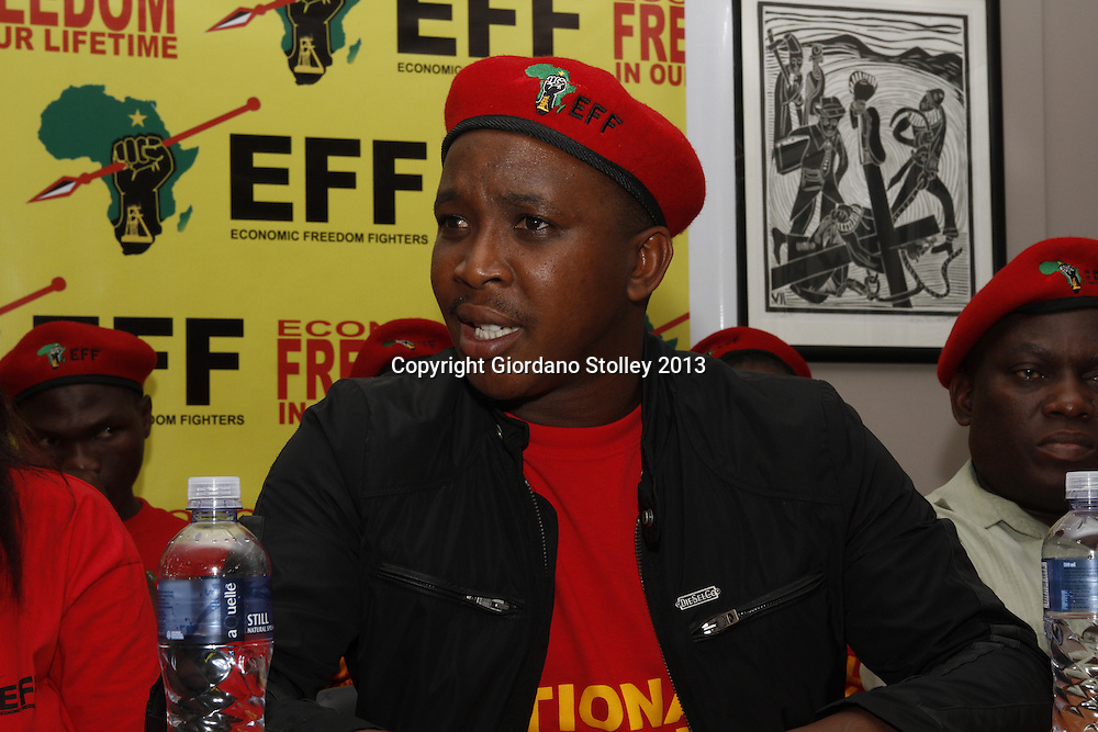 DURBAN - 14 August 2013 - Nathi Phewa, the KwaZulu-Natal coordinator of the newly formed Economic Freedom Fighters political party speaks at the party's first press briefing in KwaZulu-Natal. In the background to the left is Mncedisi Msibi , a member of EFF's KwaZulu-Natal command team. In the right foreground next to him is Nhlanhla Buthelezi, formerly a senior member of the Congress of the People. EFF was founded by expelled ANC Youth League president Julius Malema. Its key policies include expropriation of land without compensation and the nationalisation of mines and banks among others. Picture: Giordano Stolley