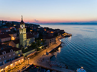 Aerial view of Sutivan church tower during the night, Croatia.