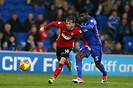 Joe Garner of Ipswich Town breaks away from Bruno Equele Manga of Cardiff City. EFL Skybet championship match, Cardiff city v Ipswich Town at the Cardiff city stadium in Cardiff, South Wales on Tuesday 31st October 2017.<br /> pic by Andrew Orchard, Andrew Orchard sports photography.