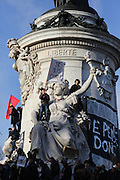 """A massive public rally """"Cry for Freedom"""" takes place in central Paris on Sunday afternoon. Protesters mount the Republique statue with """"Je Suis Charlie flag"""". The rally brought in people of all colors and creeds from both France and abroad. Many were carrying placards with various slogans. This demonstration happened the weekend after armed gunmen attacked the offices of Charlie Hebdo, killing twelve people, including the editor and celebrated cartoonists; four more are in critical condition. It is the dealiest terror attack in France for over fifty years. Charlie Hebdo is a satirical publication well known for its political cartoons. The jihadists responsible were killed by police in several shootouts on the Friday afternoon. <br /><br />As a solidarity actions with the deaths at Charlie Hebdo many placards read """"Je suis Charlie"""" translating as """"I am Charlie (Hebdo)"""". Demonstrators held aloft pens, brushes and crayons, symbolizing the profession of journalists and cartoonists who were killed. Many pens were placed in a shrine with candles in the square. Some protesters also refused to ally themselves with Charlie Hebdo."""