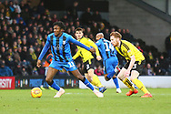 Gillingham FC midfielder Regan Charles-Cook (11) shields the ball from Burton Albion's Reece Hutchinson (23) during the EFL Sky Bet League 1 match between Burton Albion and Gillingham at the Pirelli Stadium, Burton upon Trent, England on 12 January 2019.