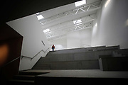 A worker walks through Steven Holl's Sifen Art Museum, which is still under construction at the CIPEA park in Nanjing, China on 04 March, 2011.