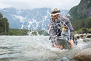 A fiesty Dean River chinook gives Pat Bogdan a face wash just before release.