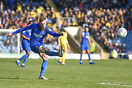 AFC Wimbledon midfielder Scott Wagstaff (7) takes a shot at goal during the EFL Sky Bet League 1 match between Oxford United and AFC Wimbledon at the Kassam Stadium, Oxford, England on 13 April 2019.