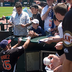 From left, Detroit Tigers prospect Gorkys Hernandez (cq), Chicago Cubs prospect Geovany Sota (cq), and Clevand's Max Ramirez (cq) of the World Team sign autographs in the dugout before the 2007 XM All-Star Futures Game, Sunday, July 8 at AT&T Park in San Francisco...Photo by David Calvert/MLB.com