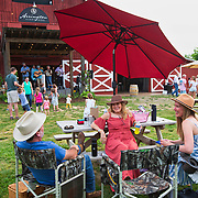 Rich and Brenda Thurman, left, talk with Kristin Leonard while listening to bluegrass music outside the barn at Arrington Vineyards in Arrington, Tennessee. Nathan Lambrecht/Journal Communications