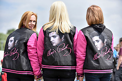 """© Licensed to London News Pictures. 23/07/2017. London, UK. Fans attend the capital's first ever """"Elvis Fest"""" to mark the 40th anniversary of the King of Rock N' Roll's death.  Taking place in Parsloes Park, Dagenham, the festival includes a variety of tribute acts representing Elvis through his career. Photo credit : Stephen Chung/LNP"""