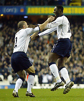Photograph: Scott Heavey.<br /> Tottenham Hotspur v Manchester City. FA Cup Fourth Round Replay. 04/02/2004.<br /> Ledley King celebrates with Stephen Carr after firing Spurs in to an early lead