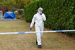 © Licensed to London News Pictures. 22/09/2019. SLOUGH, UK.  A forensics team member at work next to one of two forensics tents at Salt Hill Park in Slough, Berkshire, where it is reported a 15 year old boy was fatally stabbed after an altercation with another male.  Emergency services attended the scene at 6.30pm on the evening of 21 September where the boy was pronounced dead.  Investigations are ongoing.  Photo credit: Stephen Chung/LNP