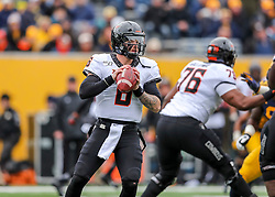 Nov 23, 2019; Morgantown, WV, USA; Oklahoma State Cowboys quarterback Dru Brown (6) drops back to pass during the first quarter against the West Virginia Mountaineers at Mountaineer Field at Milan Puskar Stadium. Mandatory Credit: Ben Queen-USA TODAY Sports