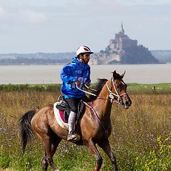 Hassan Tahous SJ Al Nuaimi, (QAT), Leonardo - Endurance - Alltech FEI World Equestrian Games™ 2014 - Normandy, France.<br /> © Hippo Foto Team - Leanjo de Koster<br /> 25/06/14