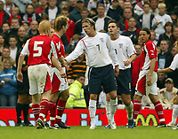Photo: Aidan Ellis.<br />England v Austria. World Cup Qualifier. 08/10/2005.<br /><br />David Beckham shakes the hand of Andreas Ibertsberger after his foul on the Austrian sees him earn his second yellow card of the game.