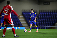 AFC Wimbledon midfielder Alex Woodyard (4) dribbling during the EFL Sky Bet League 1 match between AFC Wimbledon and Gillingham at Plough Lane, London, United Kingdom on 23 February 2021.